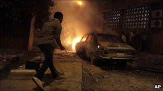 A car burns on a Cairo street, 23 July