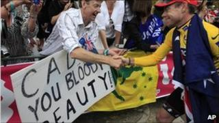 Tour de France winner Cadel Evans of Australia shakes hands with supporters after the podium ceremony in Paris, France, 24 July, 2011