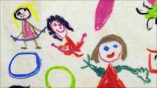 Child's crayon drawing of smiling people