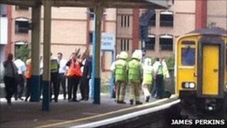 Emergency services attend the scene at Cardiff Queen Street station - photo by James Perkins