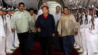 Venezuelan President Hugo Chavez (centre) arrives in Caracas from Cuba on 23 July 2011.