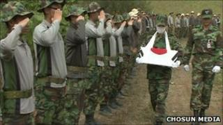 Remains of soldier being carried in a box during a ceremony in South Korea