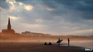 Surfers on Tynemouth beach