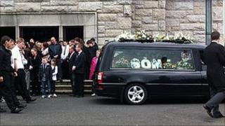 Hearse carrying Sean McNair's coffin outside church