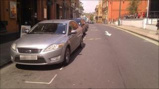 Cars parked in bays in Broad Street, Nottingham