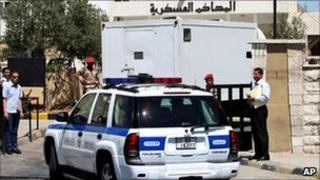 A prison van carrying Abu Mohammed al-Maqdessi at a military court in Amman, Jordan, 28 July 2011