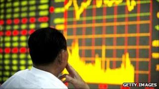 Investor watches stock market moves