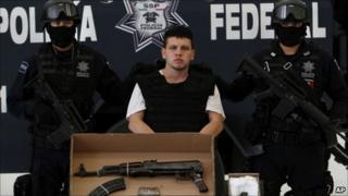 Nery Salgado Harrison is escorted by police during his presentation to the media in Mexico City, Monday 1 August 2011
