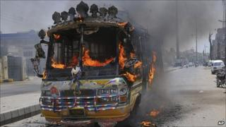 A bus burning in Karachi, 1 August 2011