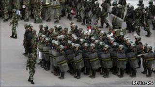 Armed police officers are deployed at a square in Kashgar (2 August)