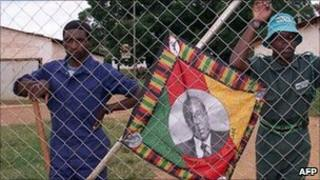 Supporters of President Robert Mugabe on a white-owned farm (2000)
