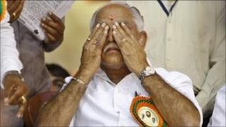 """India""""s opposition Bharatiya Janata Party (BJP) leader and southern state of Karnataka""""s Chief Minister B.S. Yeddyurappa reacts during a function organized to felicitate him before he submitted his resignation to the state governor in Bangalore, India, Sunday, July 31, 2011"""