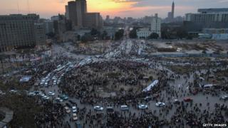 Traffic moves through Tahir Square in Cairo, Egypt, as anti-government protesters start to leave following President Mubarak's decision to quit