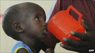 A Somali child is fed at an International Rescue Committee centre in Kenya