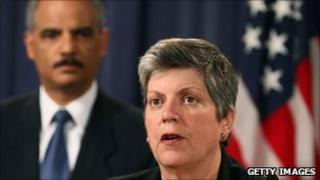 Secretary of Homeland Security Janet Napolitano speaking while Attorney General Eric Holder looks on