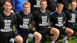 Derby County players wearing T-shirts in support of train maker Bombardier