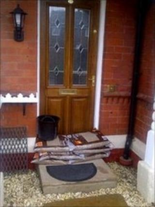 Front door covered by shop bought sandbags