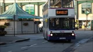 A bus pulling out of Truro bus station early in the morning