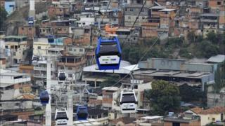 Cable cars are seen over Alemao slum after Brazil's President Dilma Rousseff opened the new transportation system in Rio de Janeiro 7 July 2011