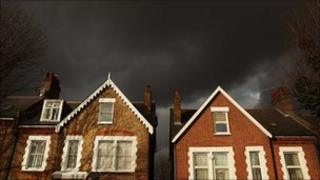 Dark clouds over a house