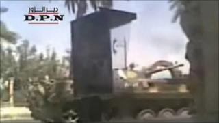 Amateur video purporting to show Syrian armoured vehicles in Deir al-Zour (7 August 2011)