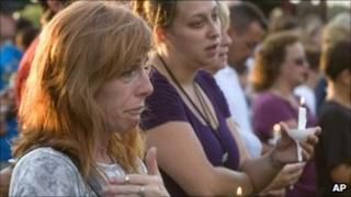Residents in Copley holding a candlelight vigil for victims of the shooting