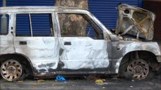 A burnt-out car in the Handsworth area