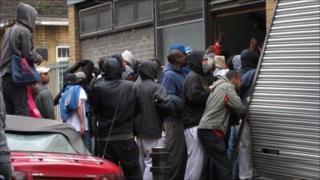 A group enter a clothes shop