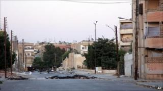 Deserted street in Hama, photographed during a government-organised tour (7 August 2011)