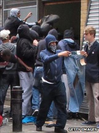 Youths loot a Carhartt store in Hackney on August 8