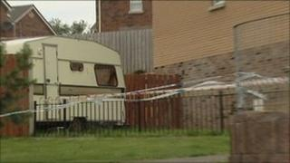 The victim was shot at his caravan in the Lagmore area