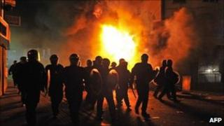 British riot police in front of a burning building in Croydon. Photo: 8 August 2011