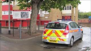 A police car by the area in Peckham where skeletal remains of a man wearing a suit were found tied up in a windsurfing bag