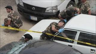 Lebanese soldiers investigate the bomb scene in Beirut on 11 August 2011