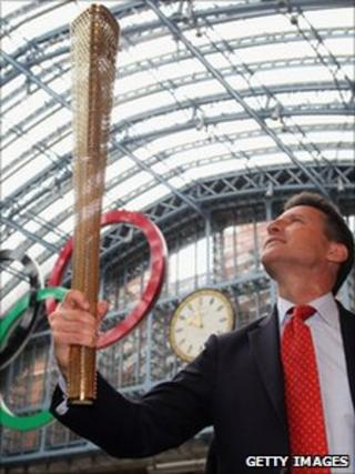 Seb Coe holding the London 2012 Olympic Torch