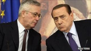 Giulio Tremonti, left, with PM Silvio Berlusconi. 12 Aug 2011