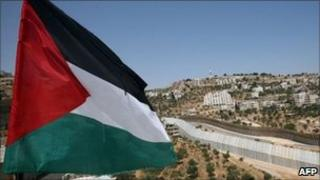 Palestinian flag in front of the separation barrier near Bethlehem, West Bank (July 2011)