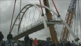 The new bridge is lifted into place