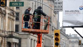 American street signs and traffic lights are put up as preparation continues for the filming of World War Z in George Square, Glasgow