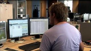 Man at computer screens