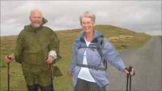 The Very Reverend Chris Potter and Sue Last tackle the elements on the walk