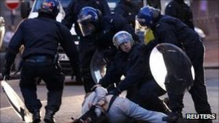 Police detain a man during disorder in Birmingham