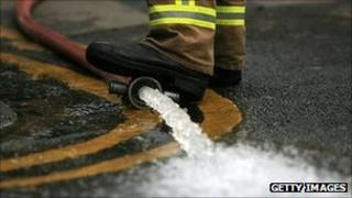 Flood water being pumped out by firefighters