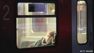 Man sleeps on train