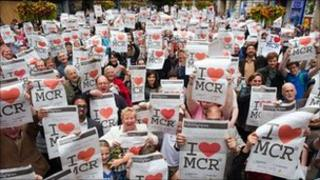 People holding I Love MCR banners