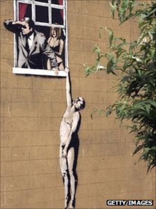 Banksy work on a building in Park Street in Bristol