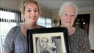 Pauline Brannigan and her mother Mary hold a photograph of Pauline taken when she was two