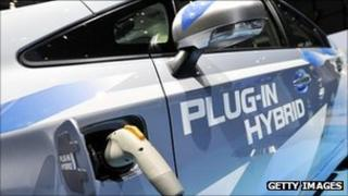 Toyota Prius hybrid car being recharged