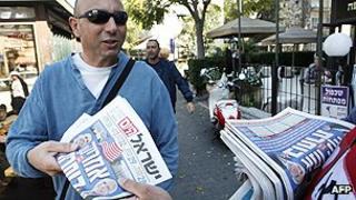Newspaper reader in Israel