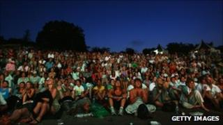 Spectators watching a match on the big screen at Wimbledon